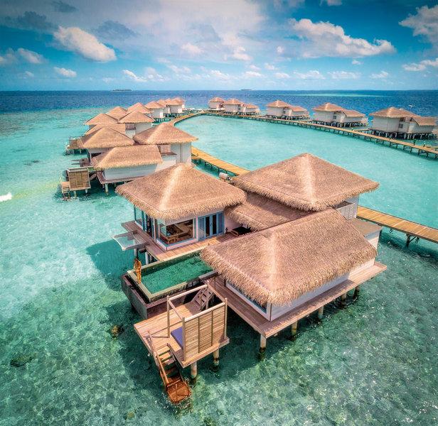 Raffles Malediven Meradhoo - Bungalows im türkisblauem Meer
